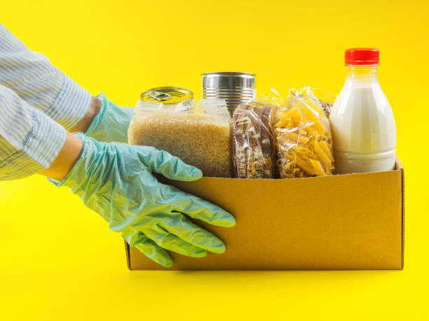 Food staples delivery or donation box concept stock photo