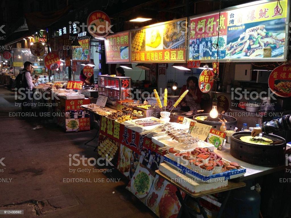 Food street by night in Xiamen, Fujian province, China stock photo