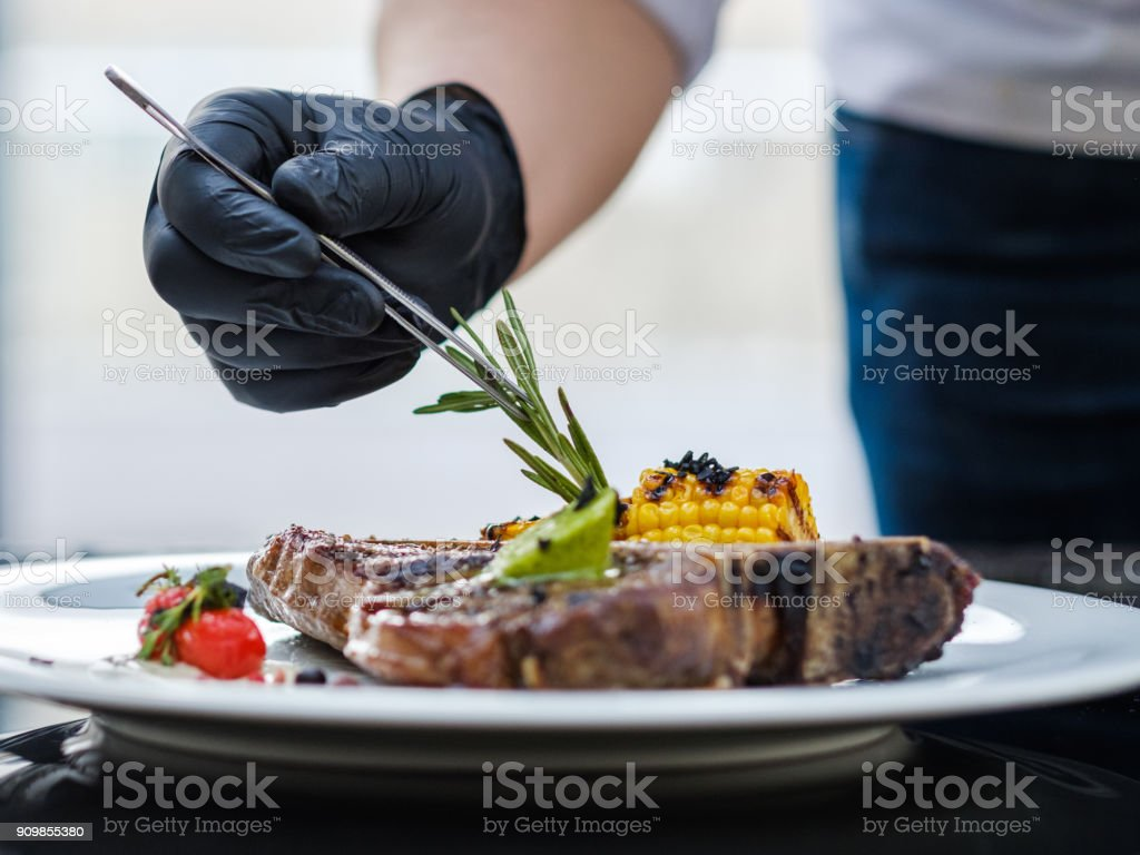 food stylist work decorating meal culinary art stock photo