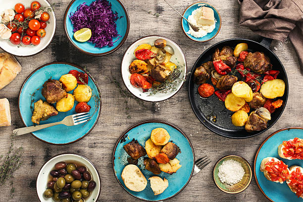 Food table, fried meat with vegetables, salad and appetizers - foto de stock