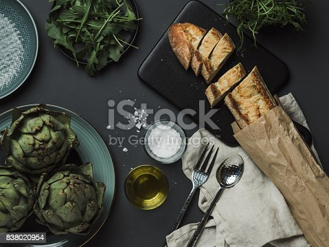 Food table setting with artichoke bread oils and salt