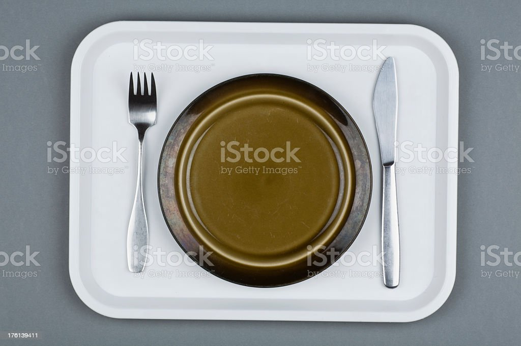 Food tray consisting of a plate and utensils royalty-free stock photo