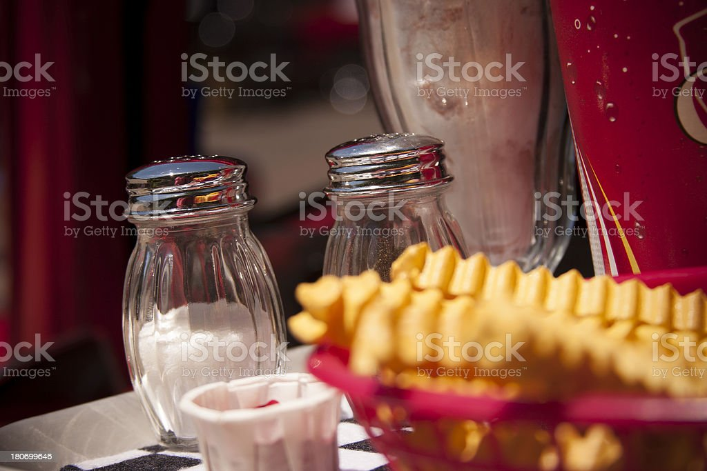 Food:  Tray placed on vehicle window with fries and drinks. royalty-free stock photo