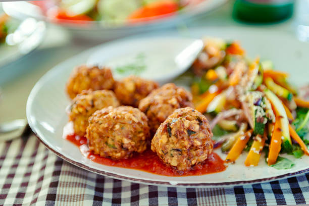 Food Trend Falafel - Vegan Food Healthy eating topic: Vegan, organic, gluten free food – alternative falafel made of chickpeas and different kinds of peas and legumes served on serbian ajvar croatian culture stock pictures, royalty-free photos & images