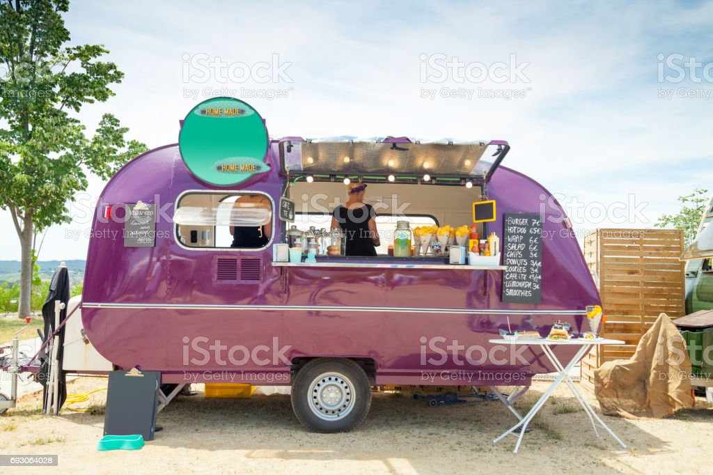 Food truck and happy owners stock photo