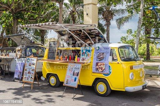 Bali, Indonesia - October 20, 2018: Food truck in a classic yellow volkswagen van at the Garuda Wisnu Kencana Cultural Park
