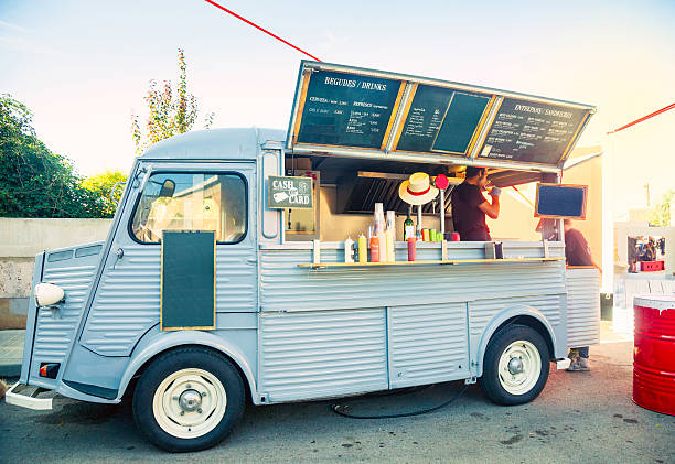 Food truck in the street Food truck open and porked in the street food truck stock pictures, royalty-free photos & images