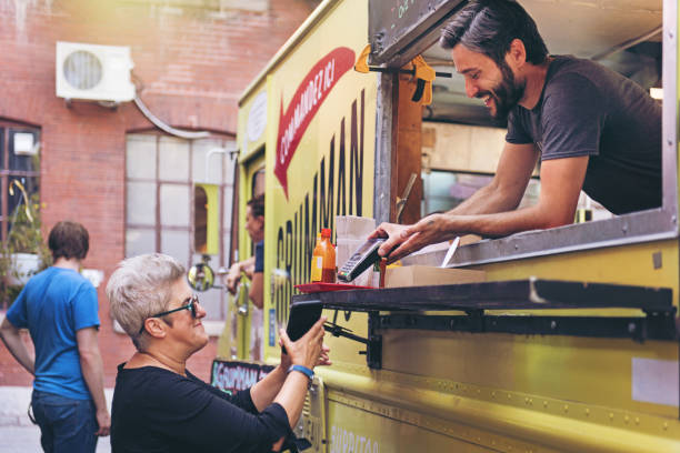Food Truck People ordering food on the street market vendor stock pictures, royalty-free photos & images