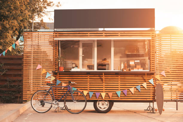 food truck with bicycle during sunset food truck with bicycle during sunset food truck stock pictures, royalty-free photos & images