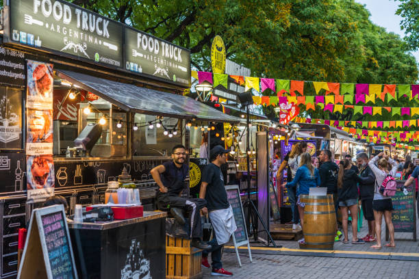 Food trucks and people at a street food market festival on a sunny day Buenos Aires, Argentina - November 25, 2018: Food trucks and people at a street food market festival on a sunny day food festival stock pictures, royalty-free photos & images