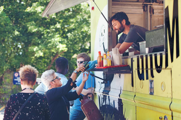 Food Trucks People ordering food on the street food truck stock pictures, royalty-free photos & images
