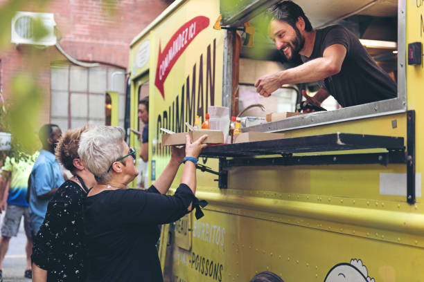 Food Trucks People ordering food on the street market vendor stock pictures, royalty-free photos & images