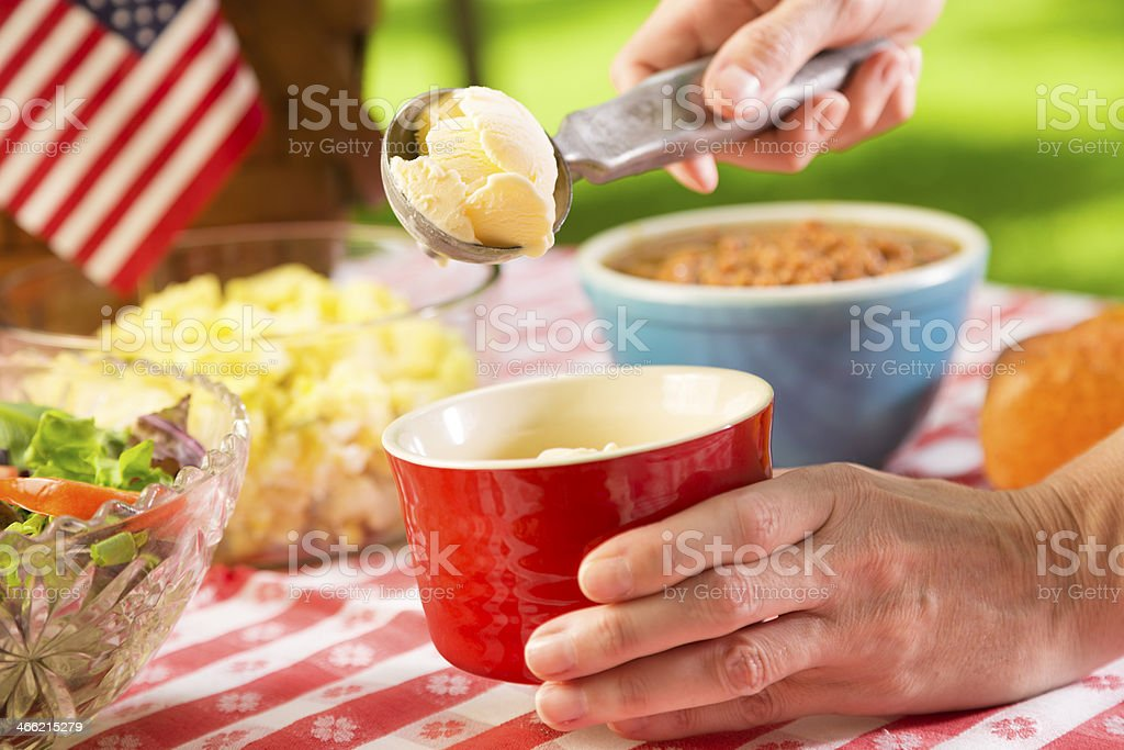 Food: Vanilla ice cream being served at a picnic. stock photo