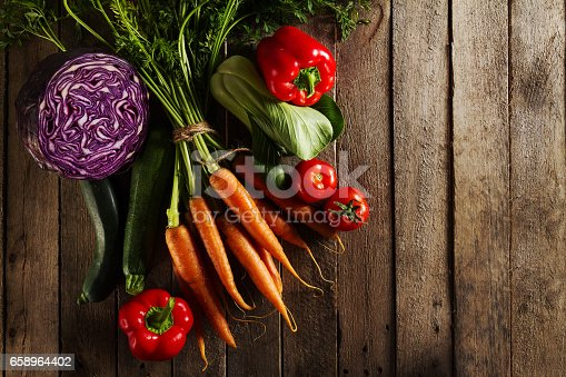 istock Food Vegetable Colorful Background. Tasty Fresh Vegetables on Wooden Table. Top View with Copy Space. Horizontal. 658964402