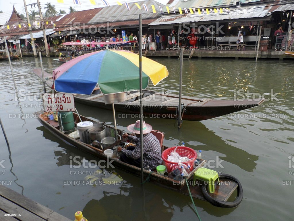 Food Vendor At Amphawa Floating Market In Thailand royalty-free stock photo
