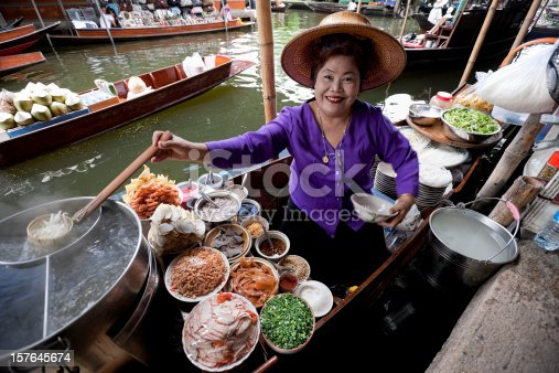 istock Food vendor at Damnoen Saduak Floating Market, Thailand. 157645674