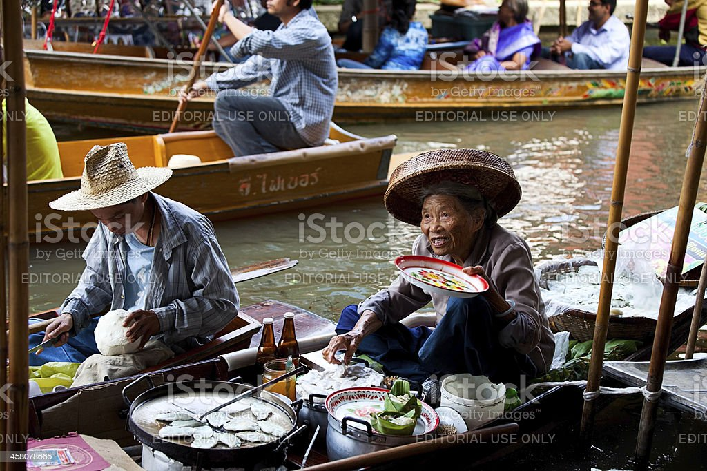 Food vendor at Damnoen Saduak Floating Market, Thailand royalty-free stock photo