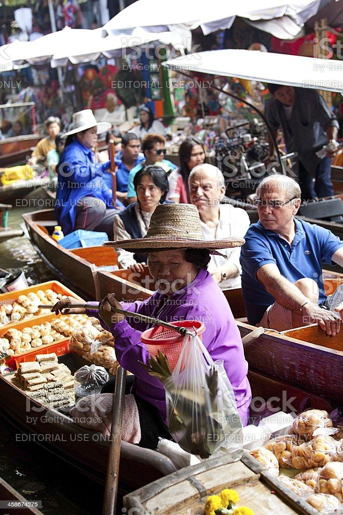 Food vendor at Damnoen Saduak Floating Market, Thailand royalty-free stock photo