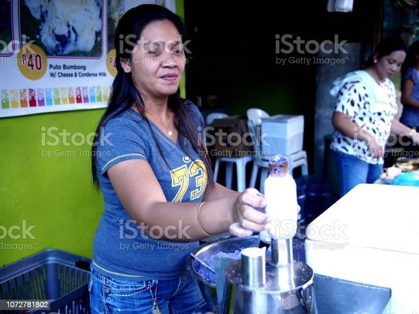 Food vendor cooks puto bumbong picture id1072781802?b=1&k=6&m=1072781802&s=612x612&h=wye585bh9jp4ccpdxfihckqjdqtf uvbccjfci 5squ=