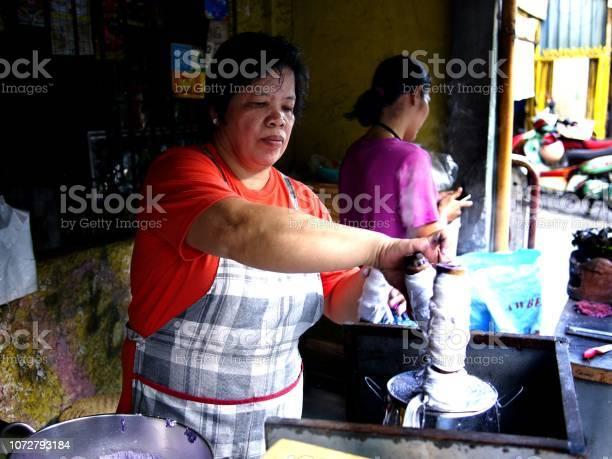 Food vendor cooks puto bumbong picture id1072793184?b=1&k=6&m=1072793184&s=612x612&h=dvhvex dczlfxl2ddt3wemxfug7agudujkakmv4e7hw=