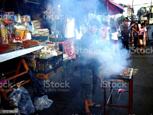 Food vendor grills pork barbecue and sells them at his makeshift picture id1072795254?b=1&k=6&m=1072795254&s=612x612&h=gem2lvuebzkrlwyl5d ihgd3zrlgyftb6qanqyaaxje=