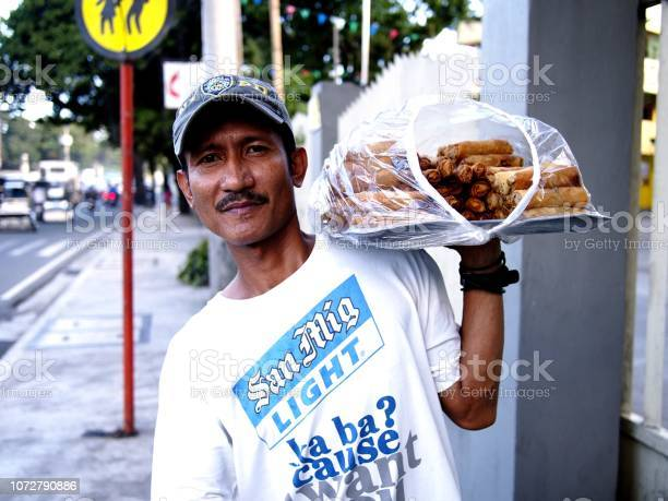Food vendor peddles deep fried vegetable rolls along a busy street picture id1072790886?b=1&k=6&m=1072790886&s=612x612&h=yucf46zct4t0oaethtrhwextdhxfb 2ufpfrfqzwoqo=