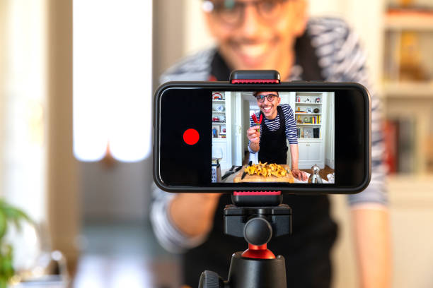 food vlogger recording live streaming - side hustle stock pictures, royalty-free photos & images