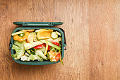 istock Food waste from domestic kitchen Responsible disposal of household food wastage in an environmentally friendly way by recycling in compost bin at home 1187344794