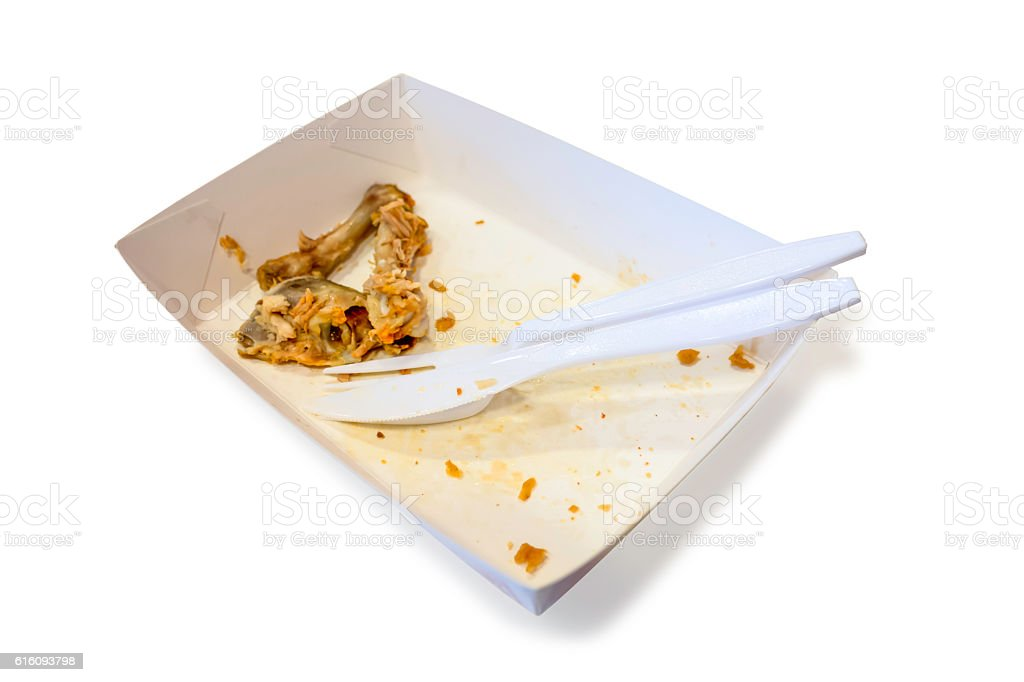 Food waste on paper plates stock photo