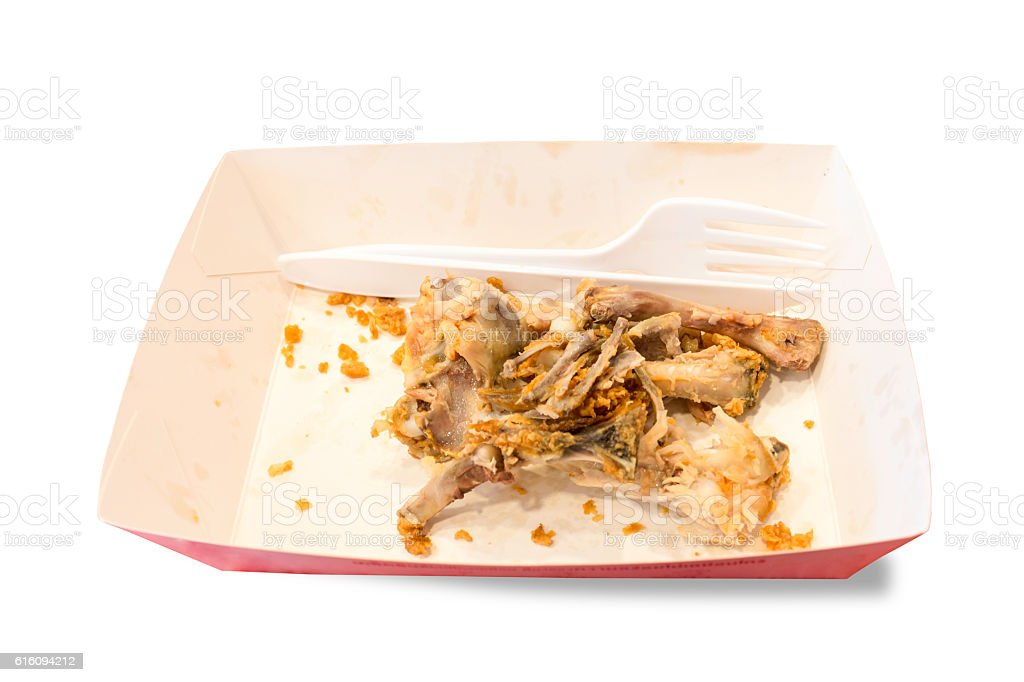 Food waste on paper plates with plastic knives stock photo