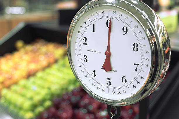 food weight scale isolated on apple background stock photo