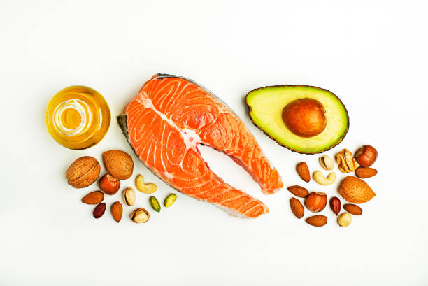 Food with high-fat benefits Selection of healthy fat food. Raw steak of salmon with fresh ingredients with high-fat benefits nut food stock pictures, royalty-free photos & images
