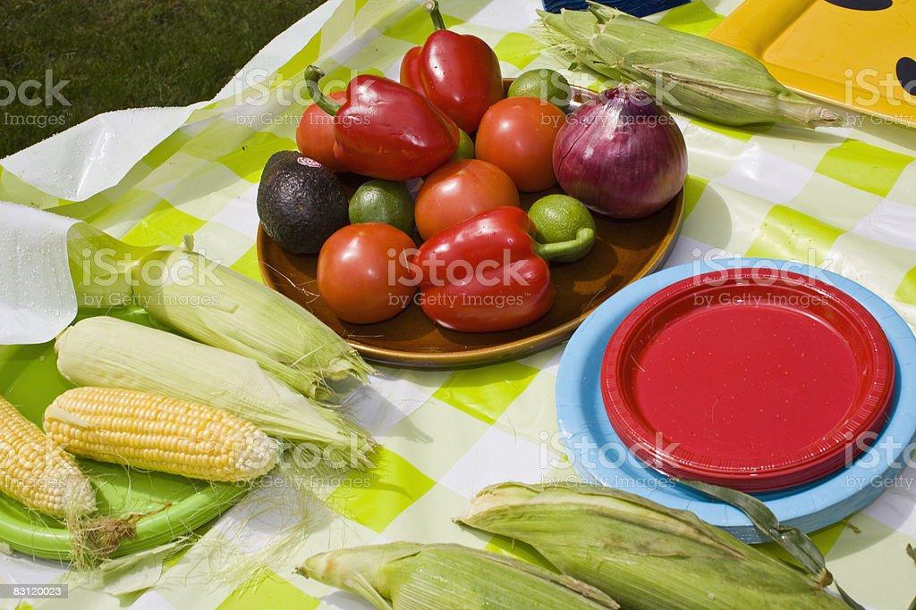 foods at picnic table royaltyfri bildbanksbilder