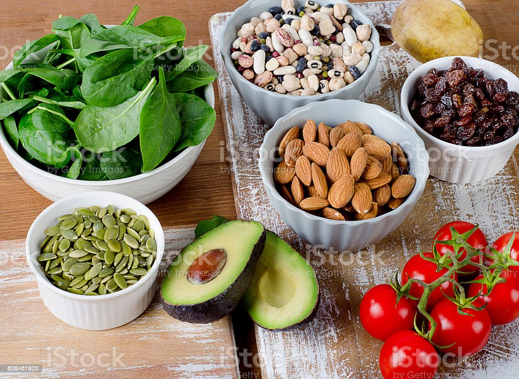 Foods containing potassium on a wooden table stock photo