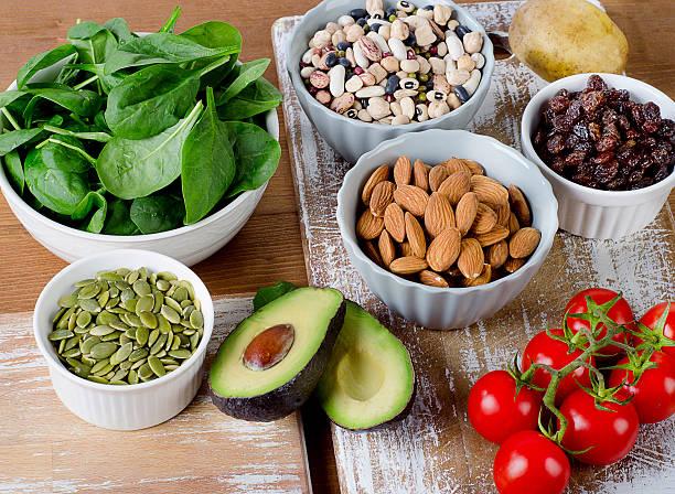 foods containing potassium on a wooden table - kalium stockfoto's en -beelden