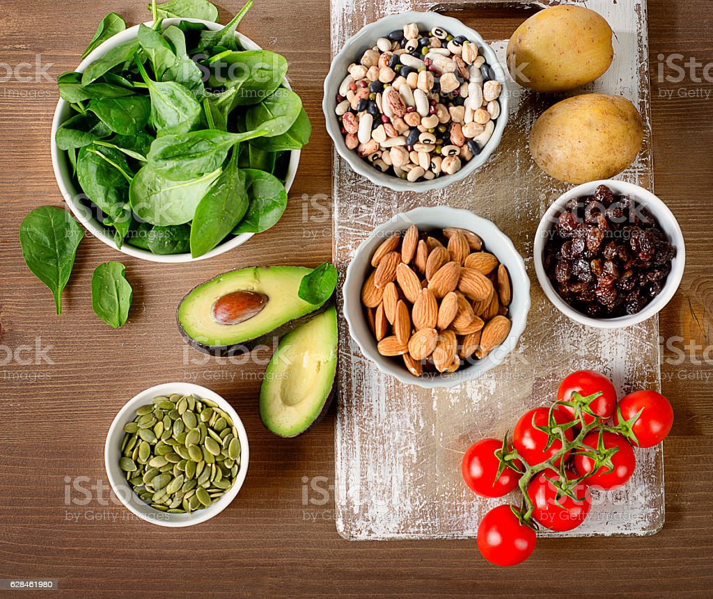 Foods containing potassium on a wooden table. stock photo