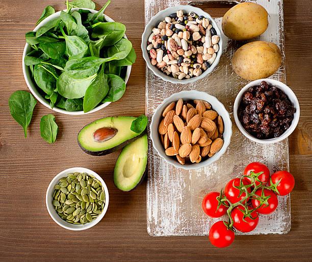 foods containing potassium on a wooden table. - буква k стоковые фото и изображения