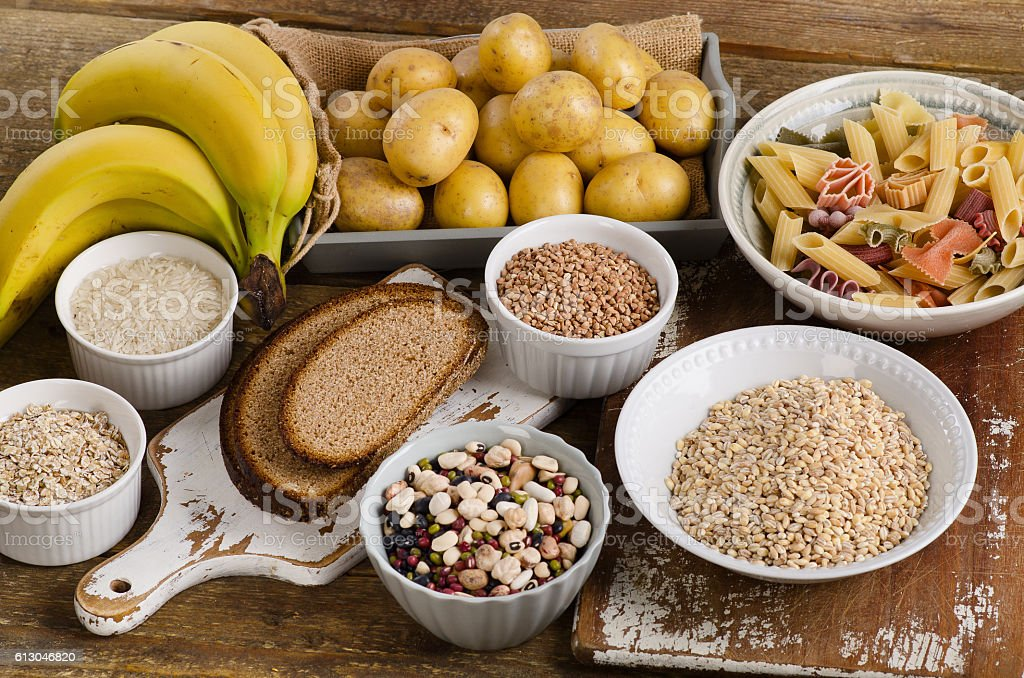 Foods high in carbohydrate on a wooden background. stock photo