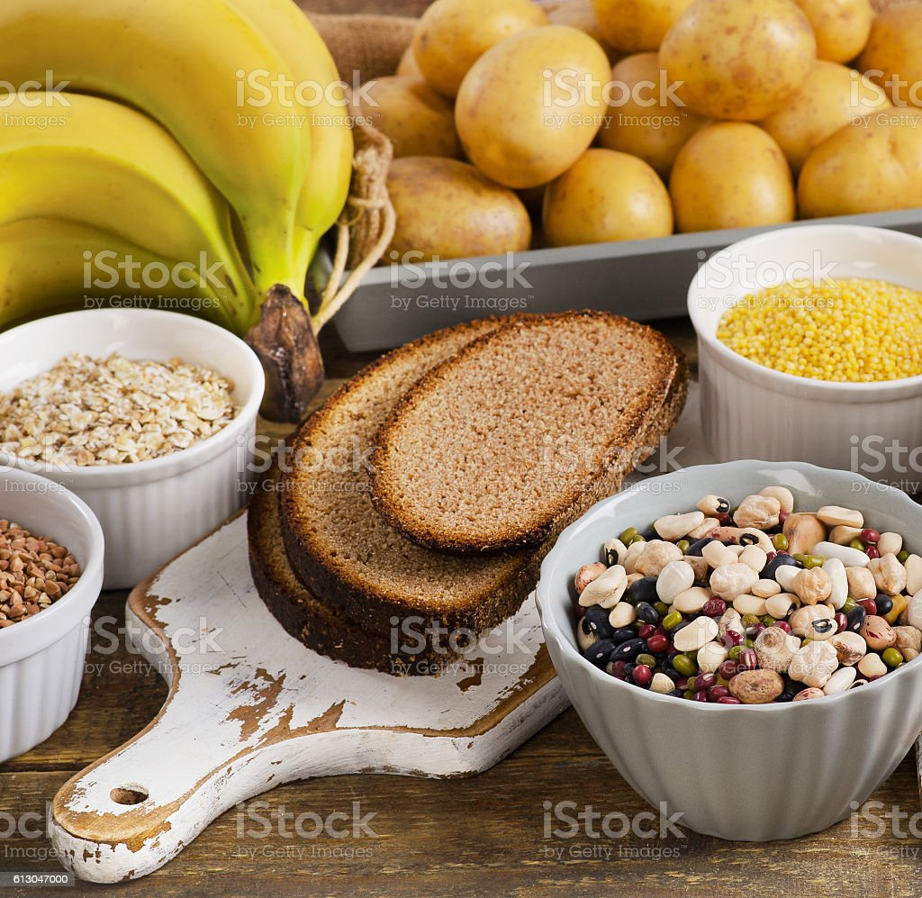 Foods high in carbohydrate on a wooden table. stock photo