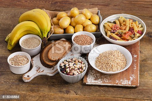 Foods high in carbohydrate on wooden background. Top view