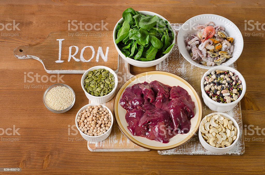 Foods high in Iron on wooden table. stock photo