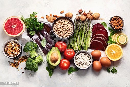 Foods high in vitamin B9. Healthy food, sources of folic acid. Top view with copy space
