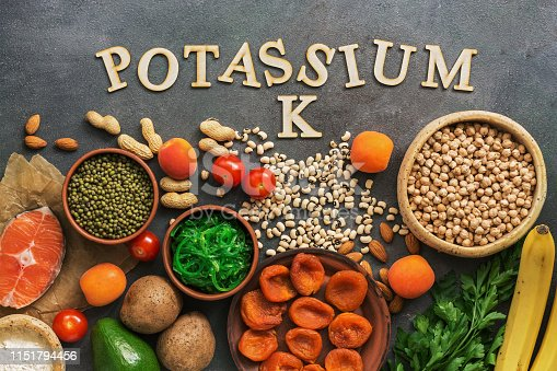 istock Foods rich in potassium, salmon, legumes, vegetables, fruits on a dark background. Healthy food concept,avitaminosis prevention. Top view, flat lay. 1151794456