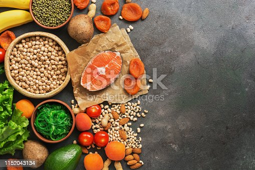 istock Foods rich in potassium, salmon, legumes, vegetables, fruits on a dark background. Healthy food concept,avitaminosis prevention. Top view, flat lay,copy space. 1152043134
