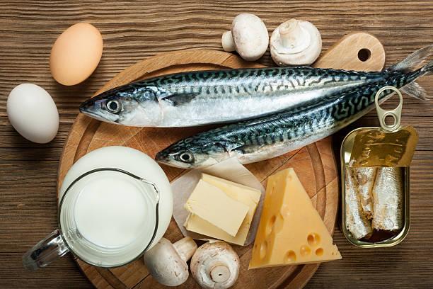 foods rich in vitamin d - vitamin d stok fotoğraflar ve resimler