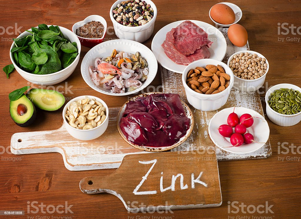Foods with Zinc mineral on a wooden table. stock photo