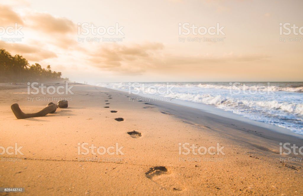 Foodsteps and sunset on the beach by Tayrona in Colombia stock photo