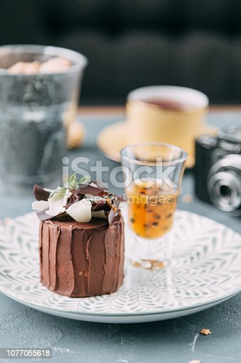 Crème brûlée with chocolate dessert with flowers. Foodstyling with tea on wooden background.