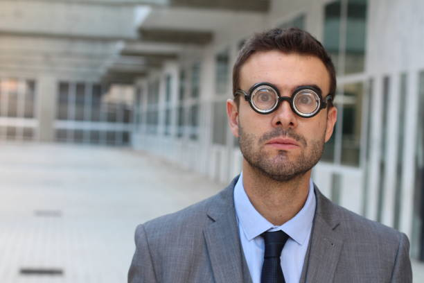 foolish geek looking stunned in the office - thick stock pictures, royalty-free photos & images
