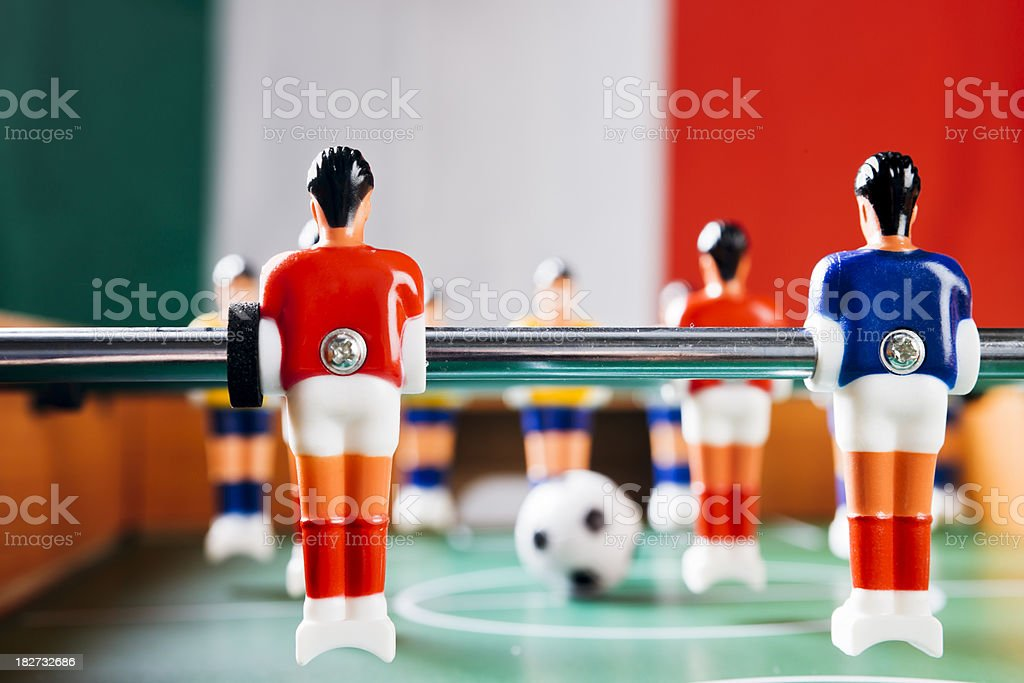 Foosball game in front of Italian national flag royalty-free stock photo